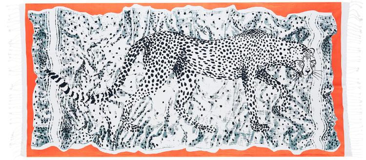 Foutas 100% coton Inouitoosh, collection 2016, la panthère Léonce en noir et blanc sur un fond blanc tacheté de points noir et bordure orange.