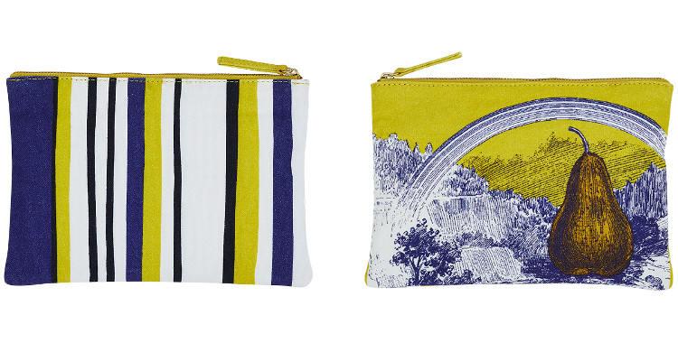 Cette pochette Inouitoosh, en coton imprimé représente une poire posée dans une vallée boisée, surmontée d'un arc-en-ciel.